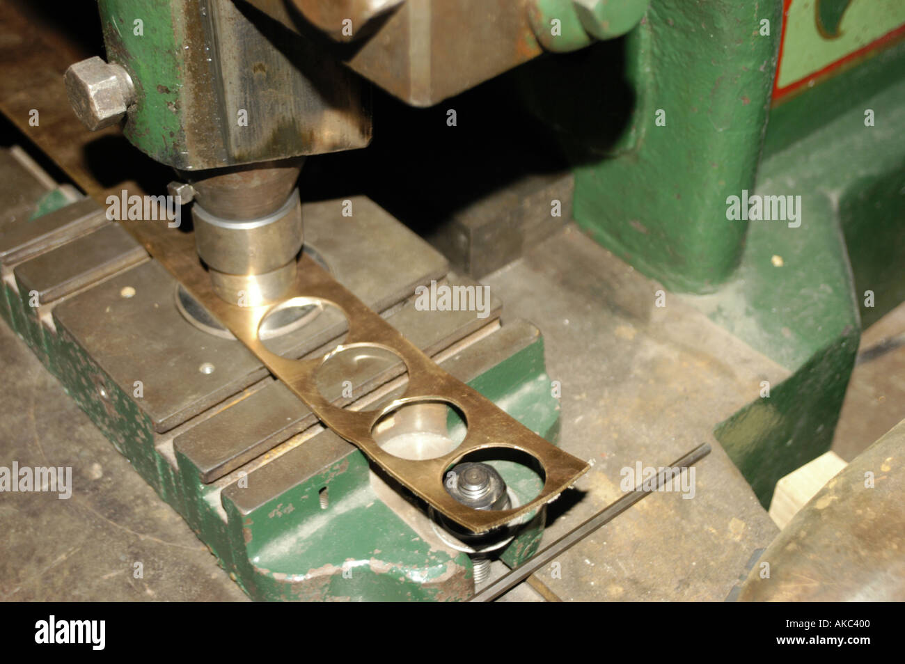 Closeup of old punch press making coin blanks Stock Photo: 1295359