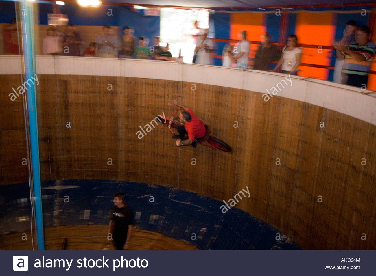 Riding the Wall of Death Fair groung attraction Motor Bikes England - Stock Image