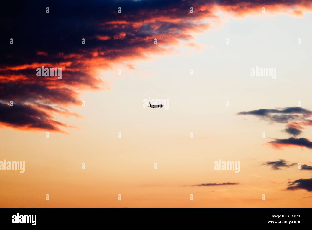Air Force One after take off in a firing cloudy red and orange sunset - Stock Image
