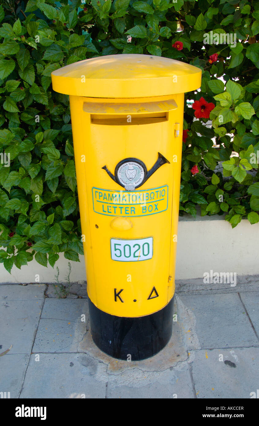 Yellow letter box on the Mediterranean island of Cyprus EU Stock Photo