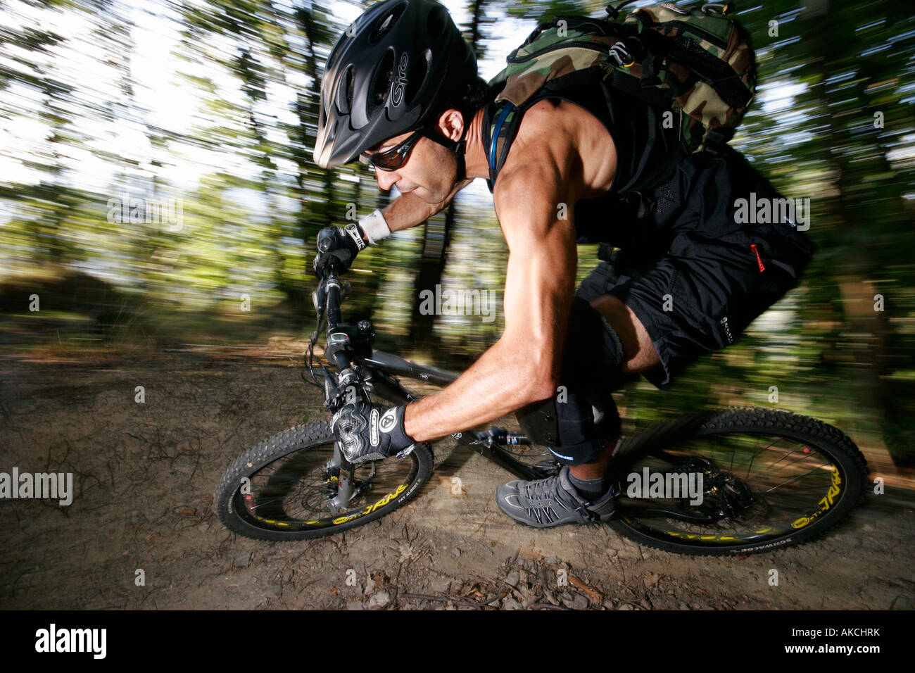 Boy riding mountain bike in the Italian Alps in the summer - Stock Image
