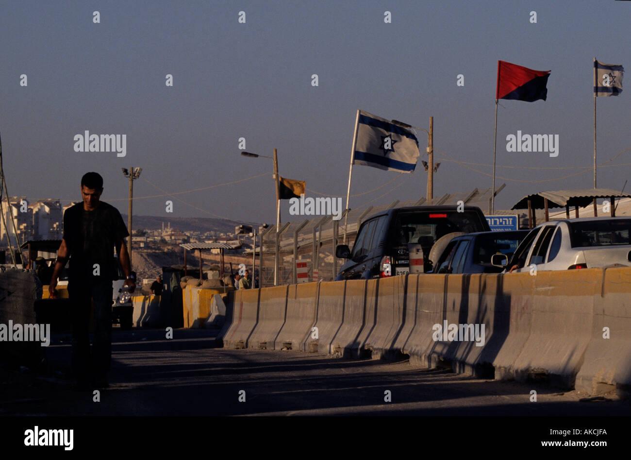 A man walking along a Palestinian highway - Stock Image
