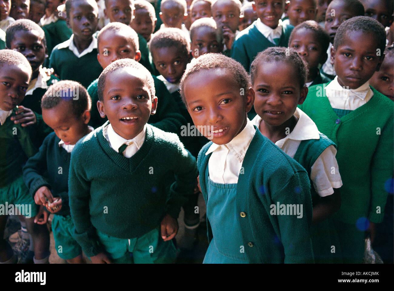 A large group of Primary School children dressed in green school uniforms in Nairobi Kenya East Africa - Stock Image