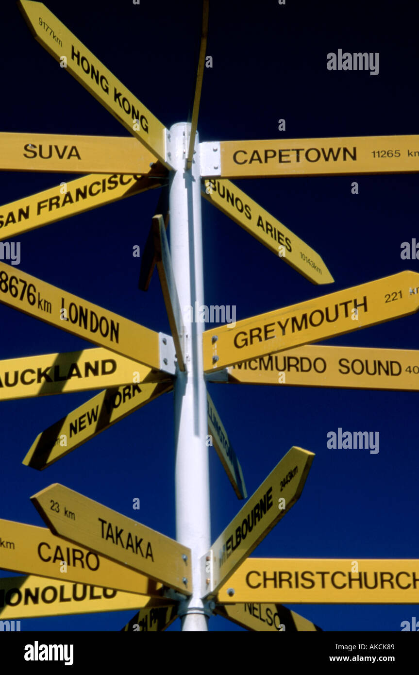 Destination sign with famous place names and distances Kaiteritrei New Zealand - Stock Image