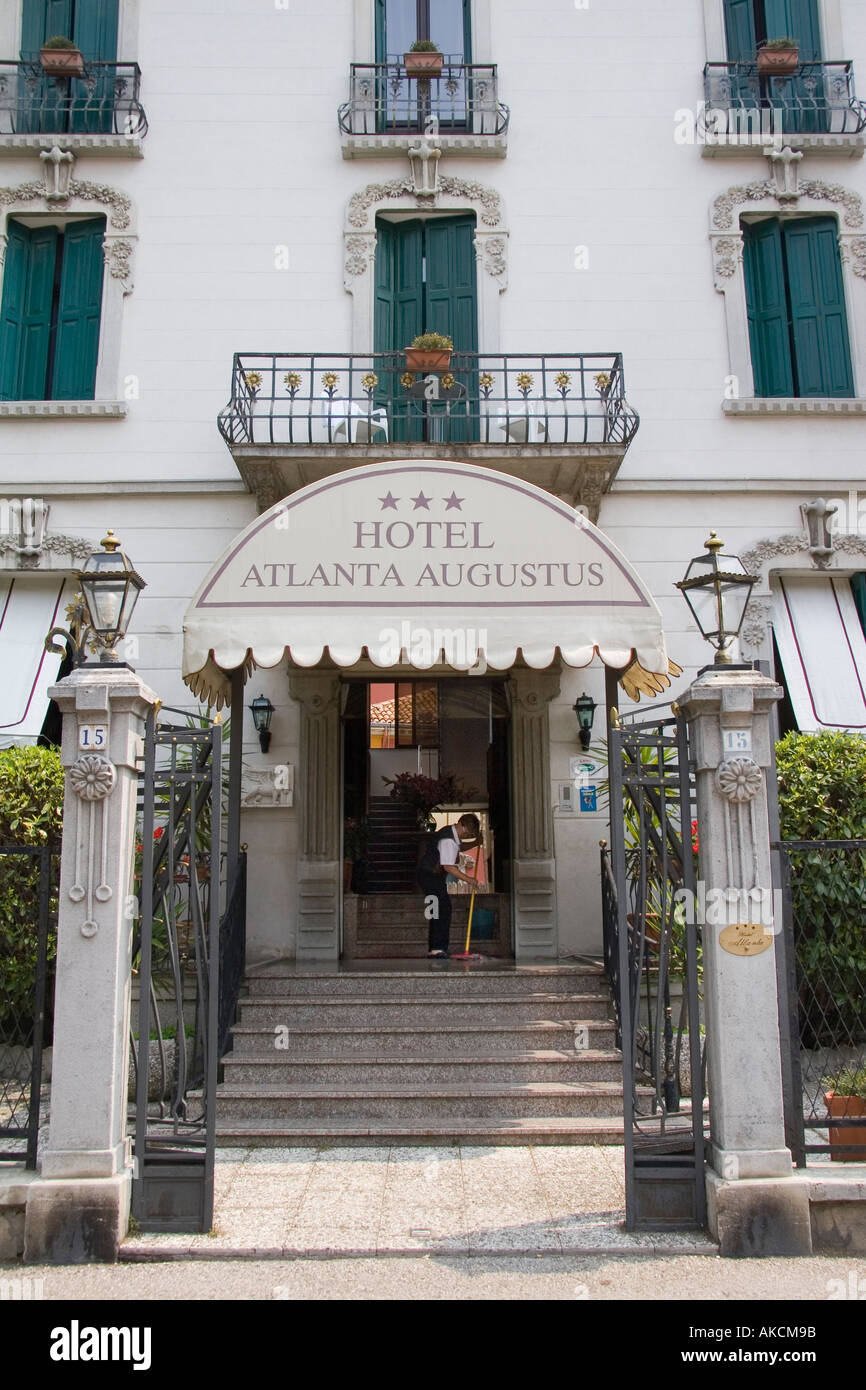 Woman sweeps entrance floor at the Hotel Alanta Agustus on the island of Lido Venice Italy Stock Photo