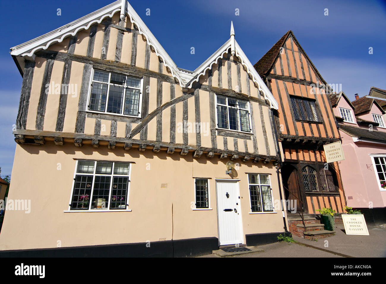 Medieval timber framed houses including the Crooked House on High Street Lavenham Suffolk East Anglia UK - Stock Image