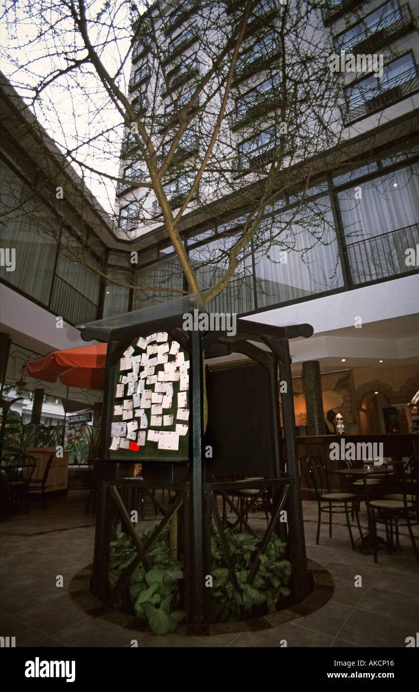 The Thorn Tree noticeboard in the Thorn Tree Cafe of the New Stanley Hotel Nairobi Kenya Famous messageboard - Stock Image