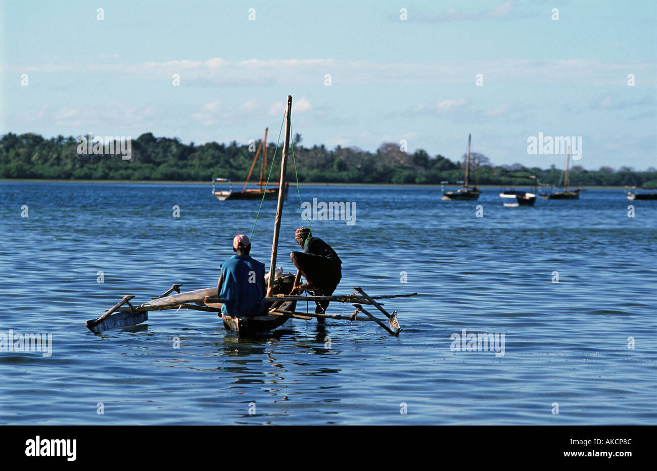 Fishermen in their outrigger canoe in the straits between Mafia and Chole island Utende Mafia lies in the Indian Ocean TANZANIA - Stock Image