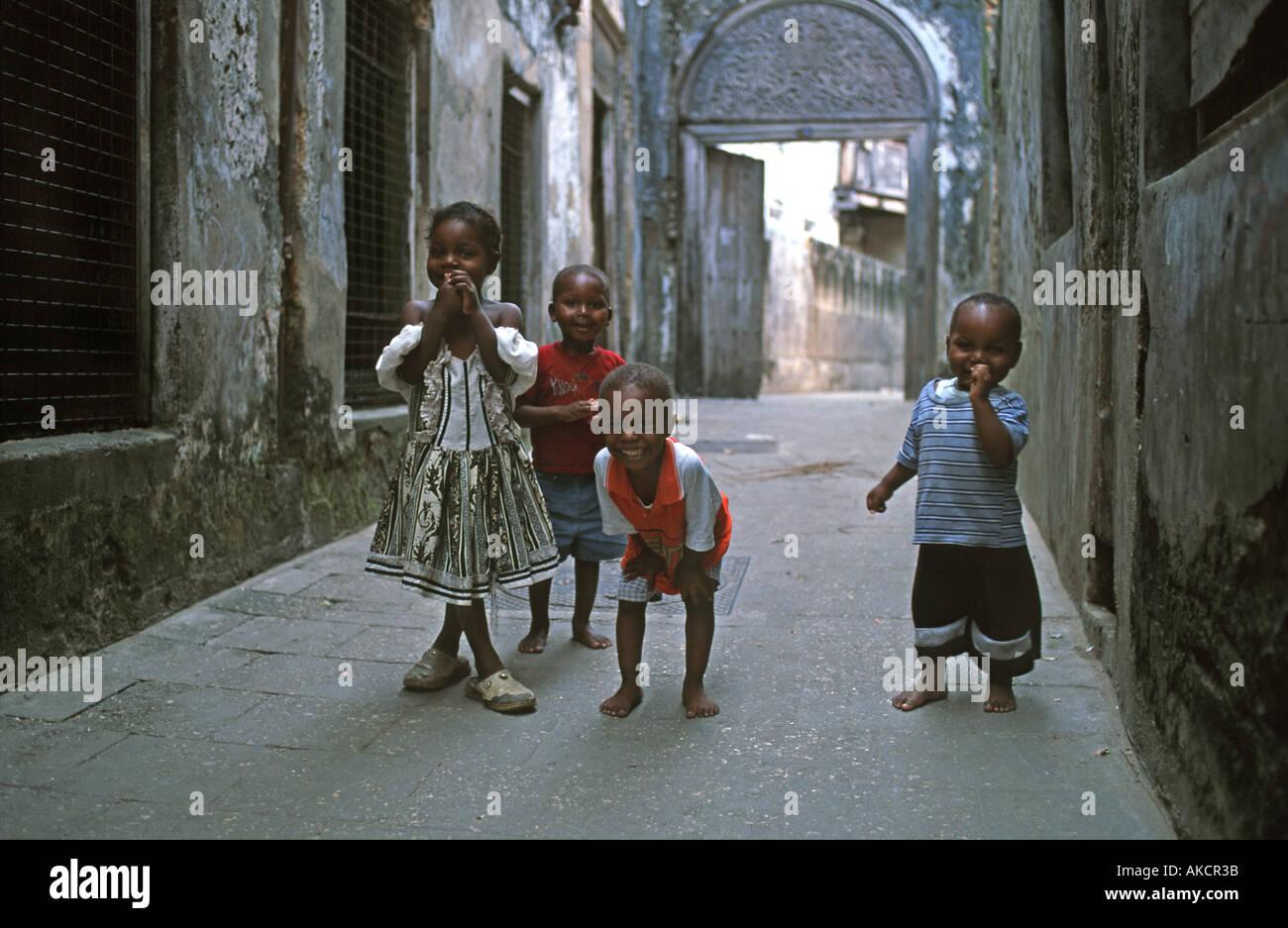 Zanzibari children playing in the street Stone Town Unguja Tanzania East Africa - Stock Image