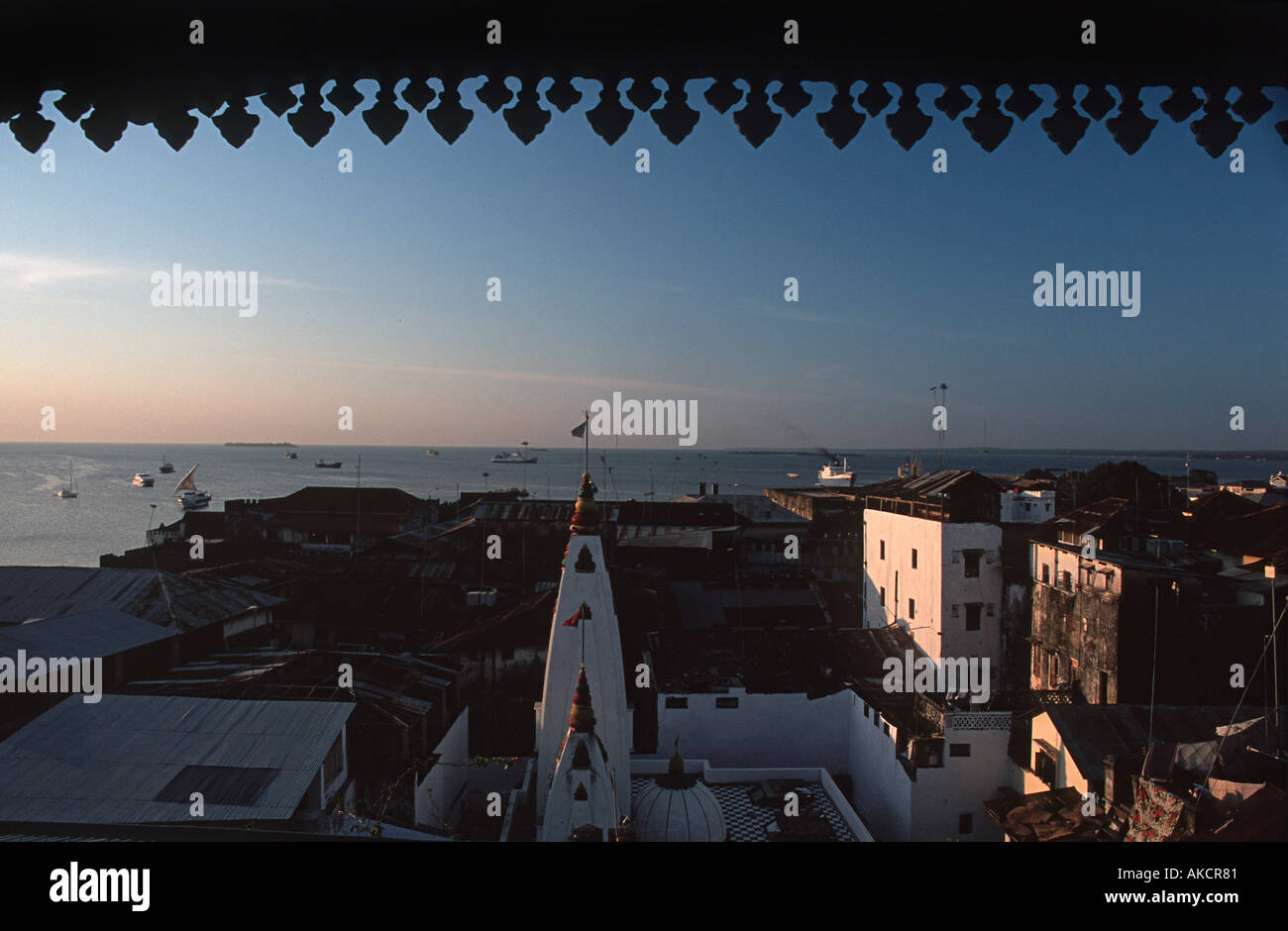 Stone Town harbour and Hindu temple viewed from the Emerson and Green rooftop restaurant and bar Stone Town Zanzibar Tanzania - Stock Image