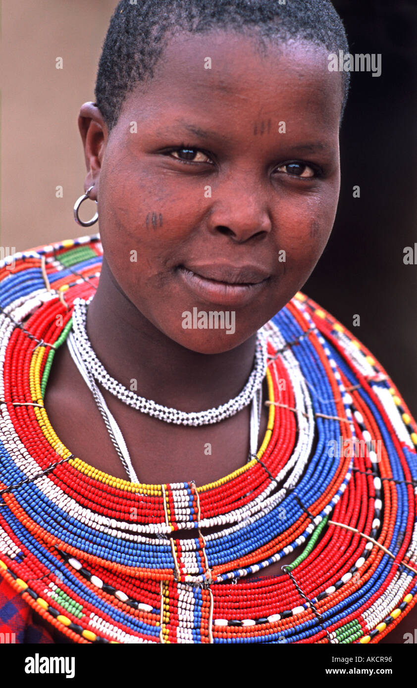 Masai woman in tribal dress and ornate beadwork necklace North of Arusha en route to southern Kenya Tanzania - Stock Image