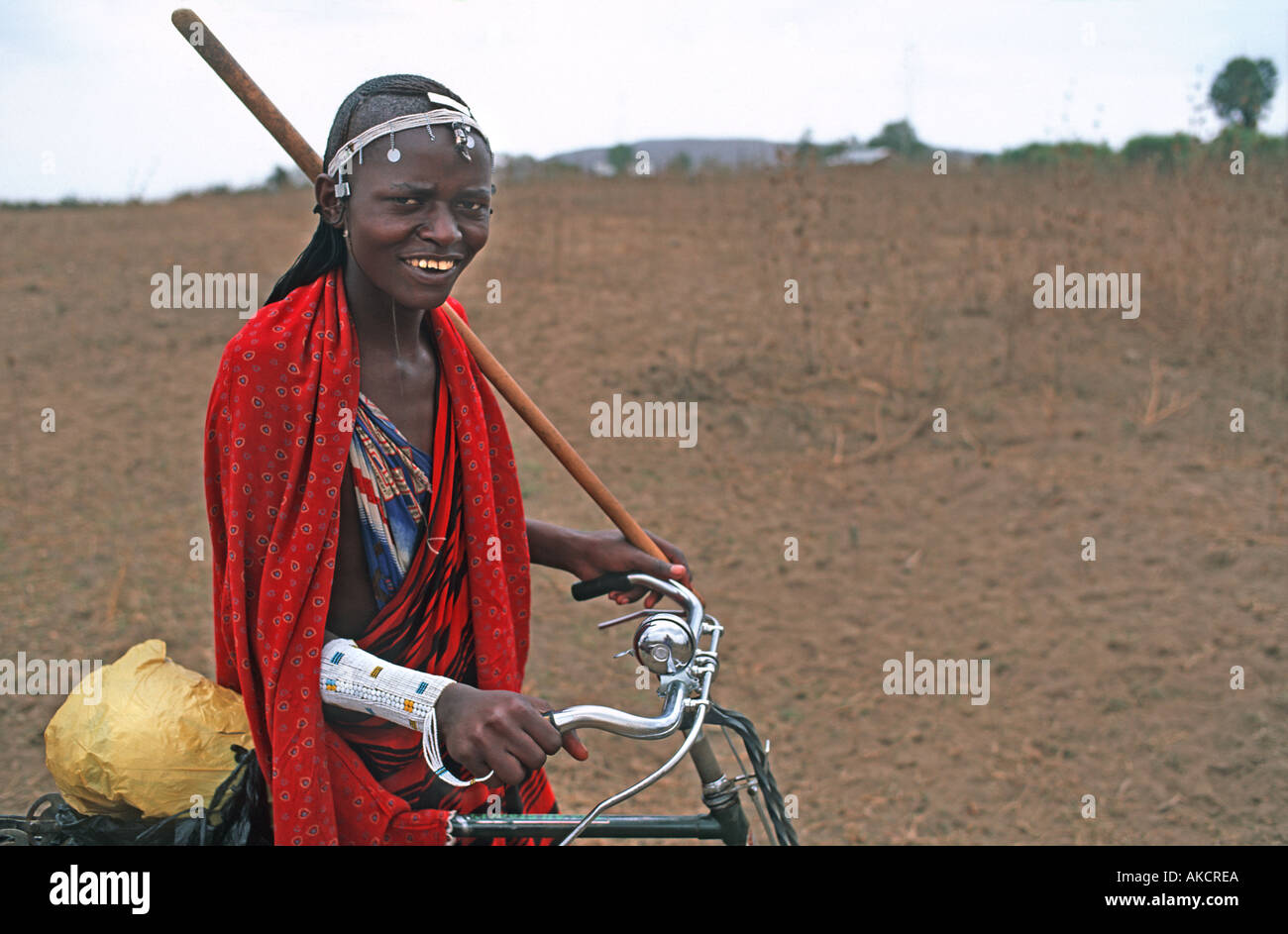 Masai warrior in tribal dress Proud owner of a bicycle Tribal lands nr the cattle market N of Arusha Tanzania E Africa - Stock Image