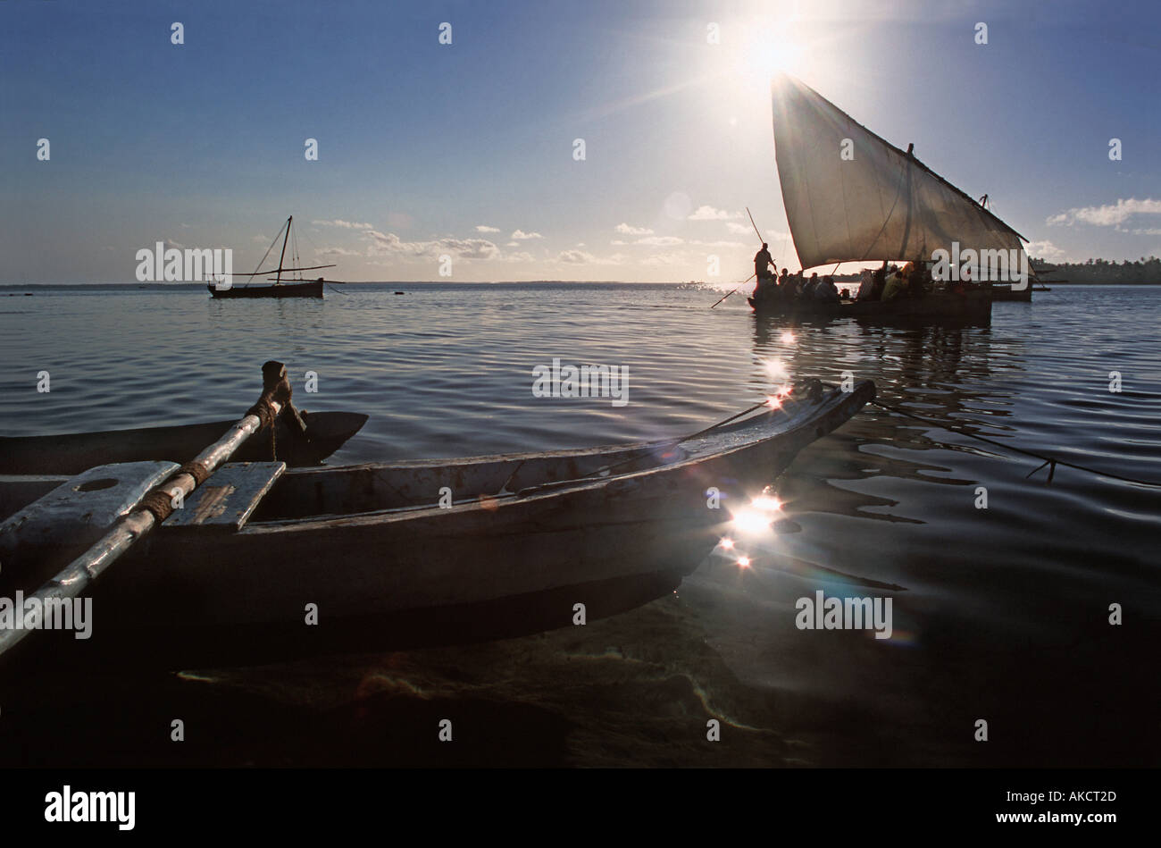 Passenger dhow ferrying people from Chole island to neighbouring Mafia island silhouetted against the rising sunStock Photo