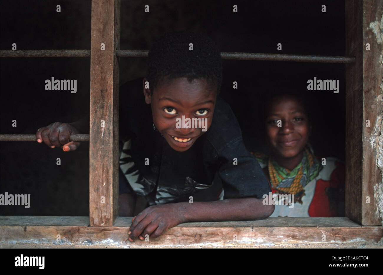 Children from Chole at the window of their home Chole lies in the Indian Ocean next to Mafia island Tanzania East Africa - Stock Image