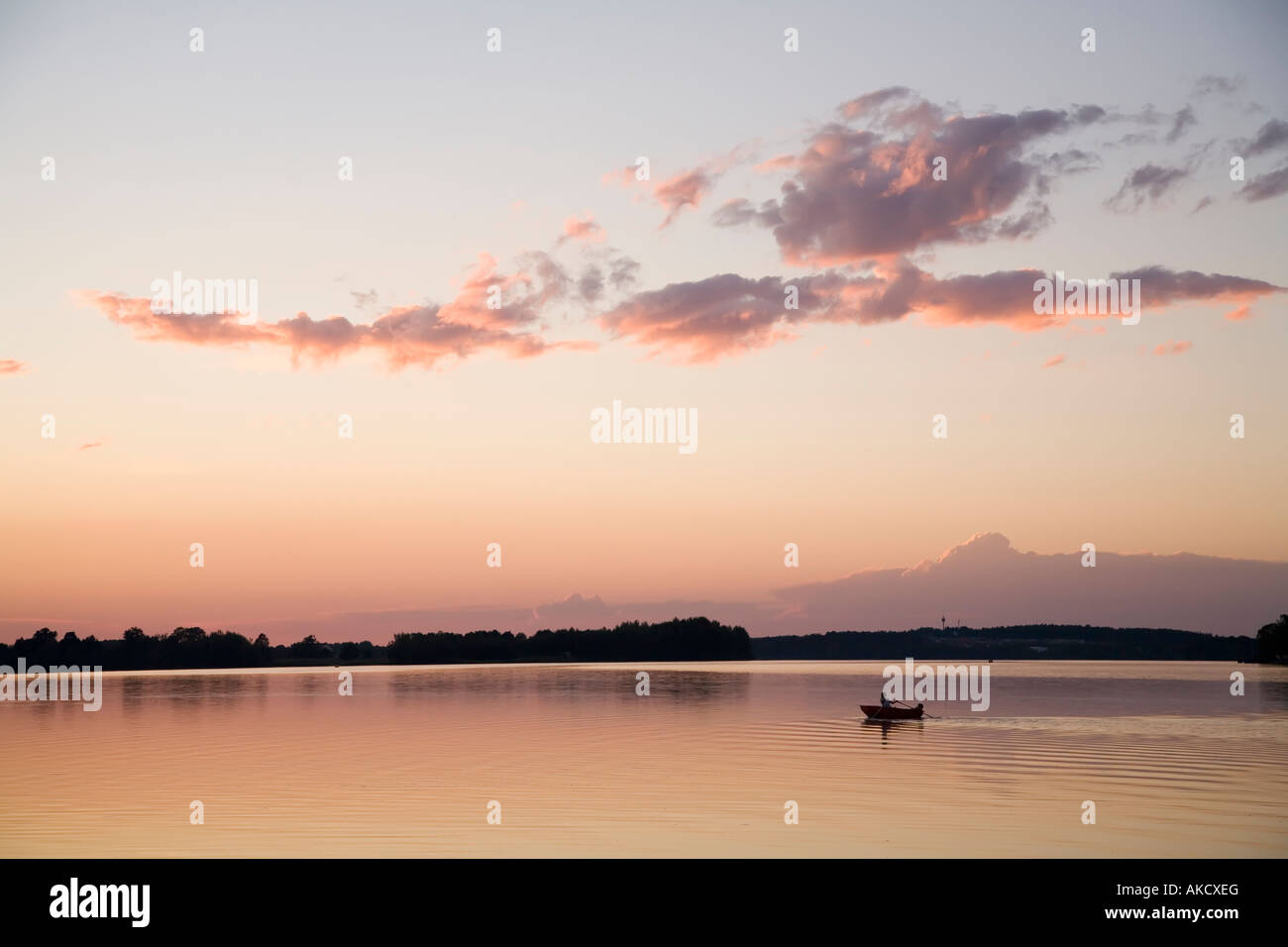 Rowing boat on Municky Rybnik lake at sunset Czech republic - Stock Image