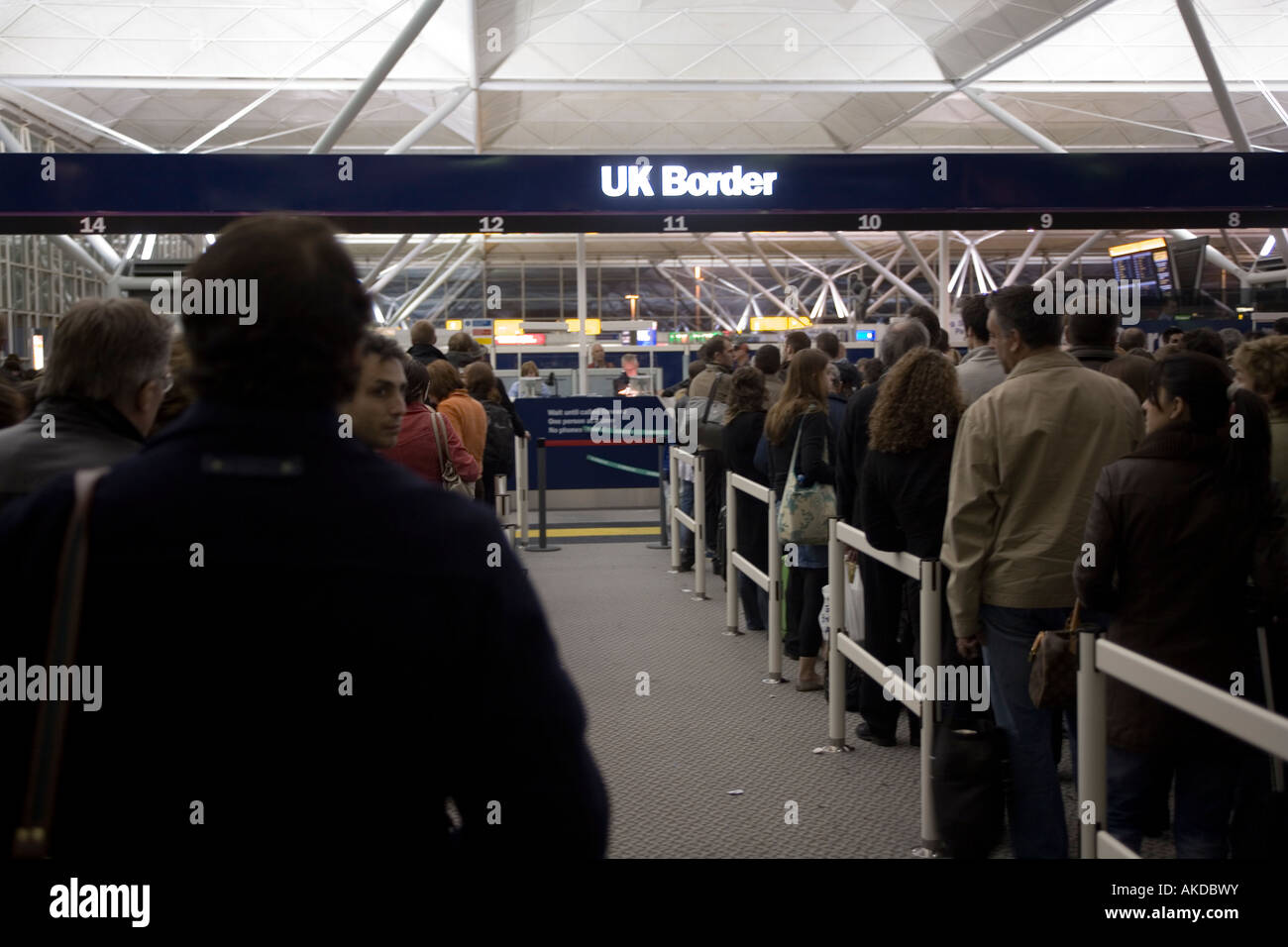 People queuing at immigration UK border, Stansted airport, London, England, Europe. - Stock Image