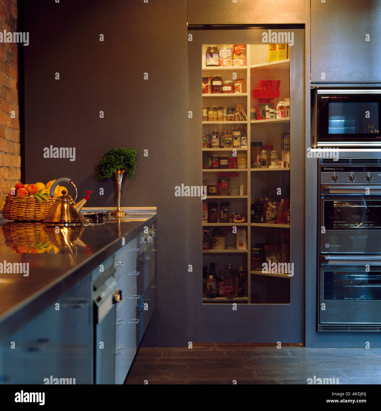 Lighting Above Shelves In Tall Cupboard With Glass Door In Modern Stock Photo Alamy