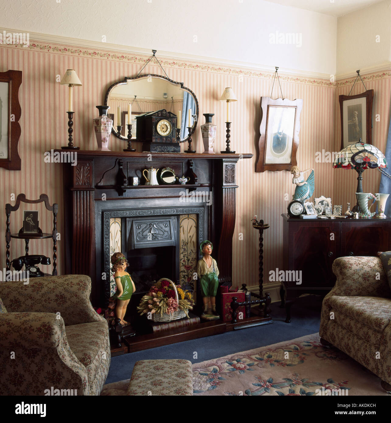 Thirties Figures In Fireplace In Small Living Room With Striped Wallpaper