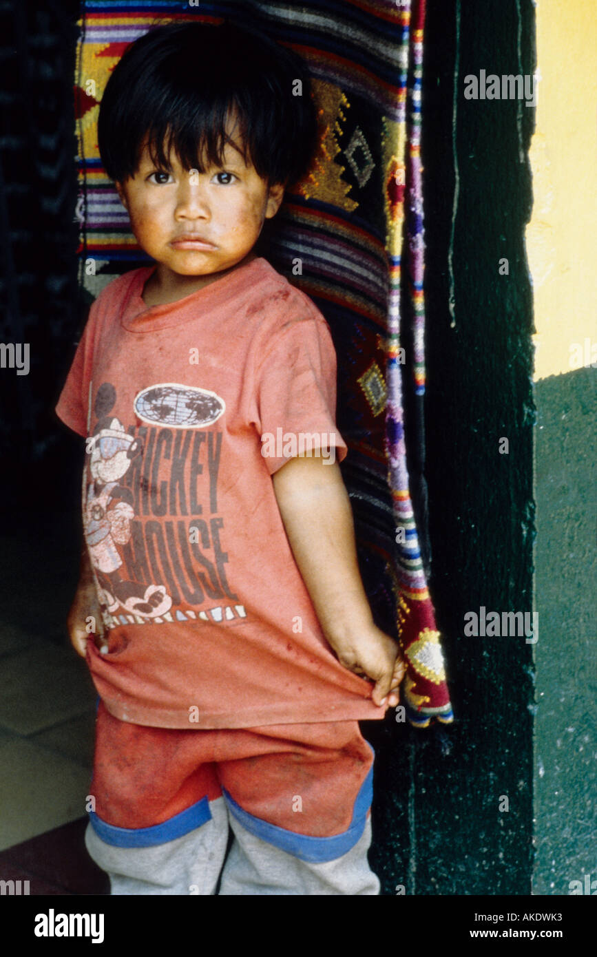 Child Standing in Doorway, Santiago Atitlan, Guatemala - Stock Image