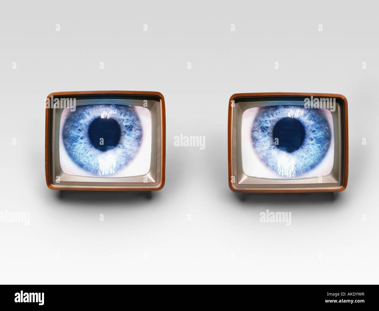 Two television sets with eyes on screens, digital composite - Stock Image
