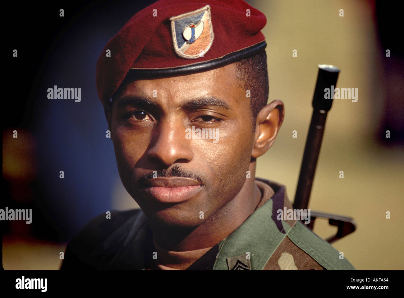 6ccacbe9 Black US Army Soldier with M 16 and Red Beret Stock Photo: 1309283 ...
