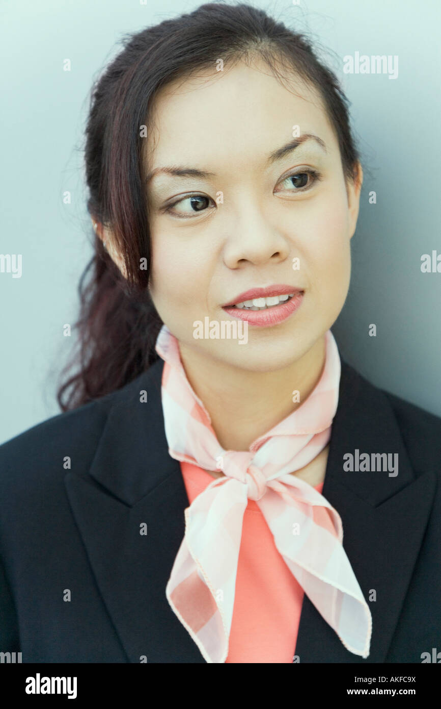 Close-up of a female cabin crew wearing a neckerchief - Stock Image
