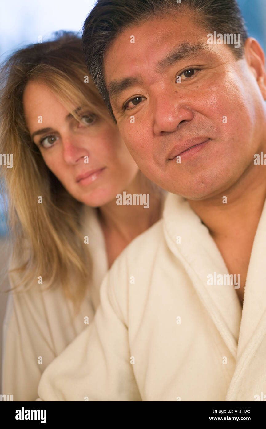 Shoulders down Asian caucasian couple with you