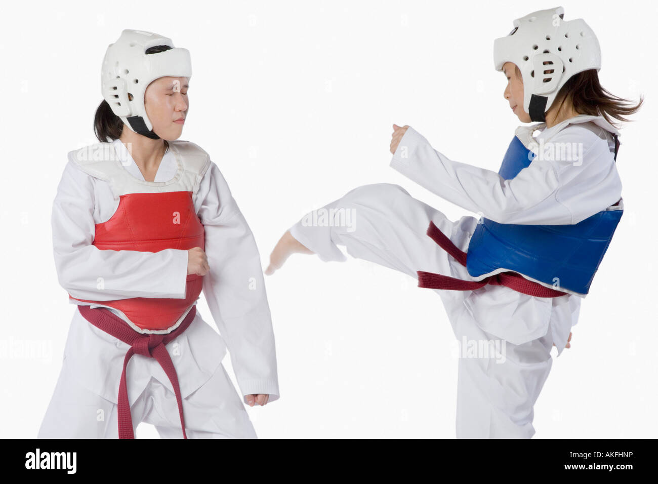 Two taekwondo players fighting - Stock Image