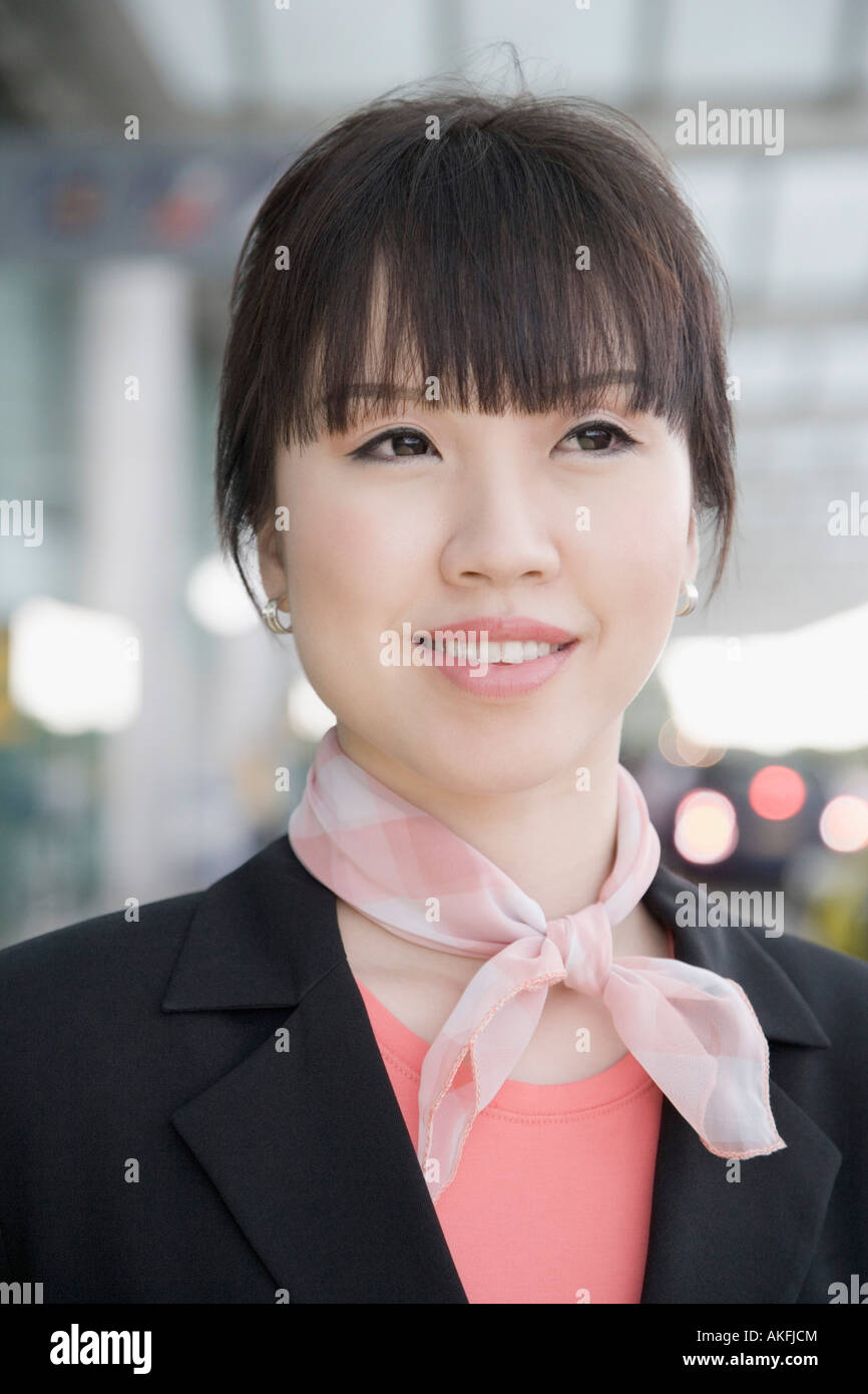 Close-up of a female cabin crew smiling Stock Photo - Alamy