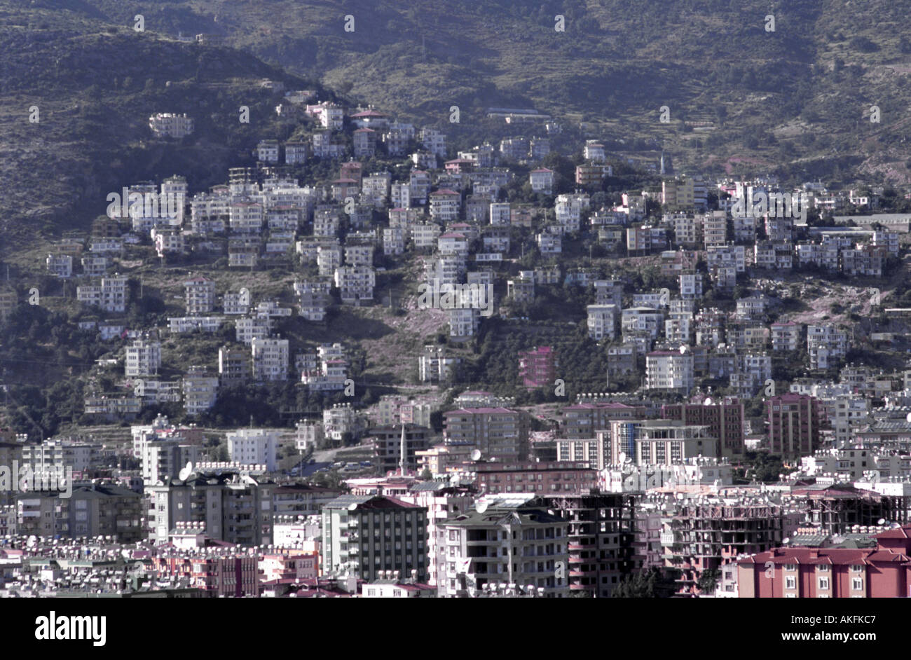 Alanya in Turkey aerial view over the city showing solar panels heating and satellite dishes - Stock Image