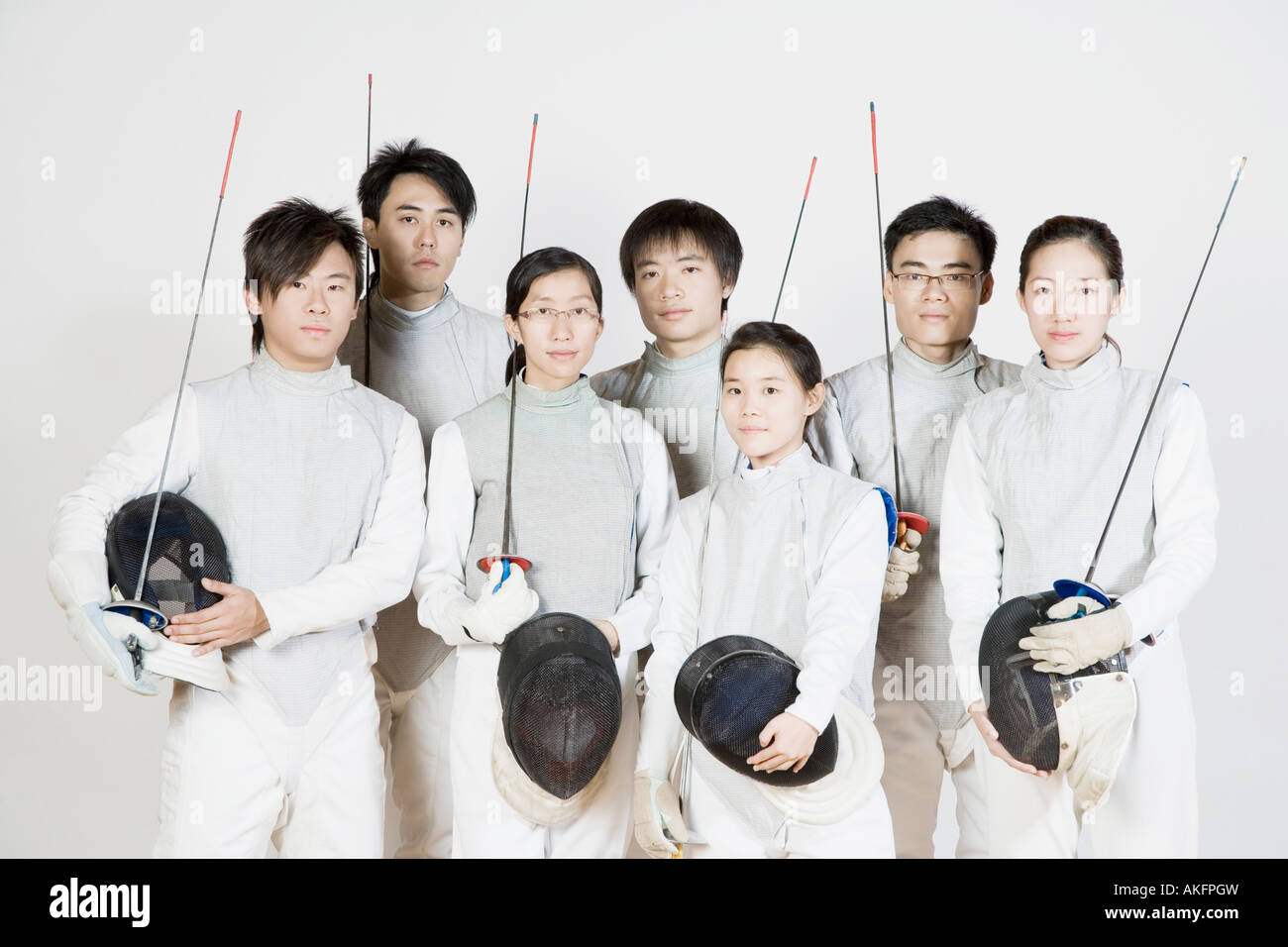 Portrait of a group of fencers standing together