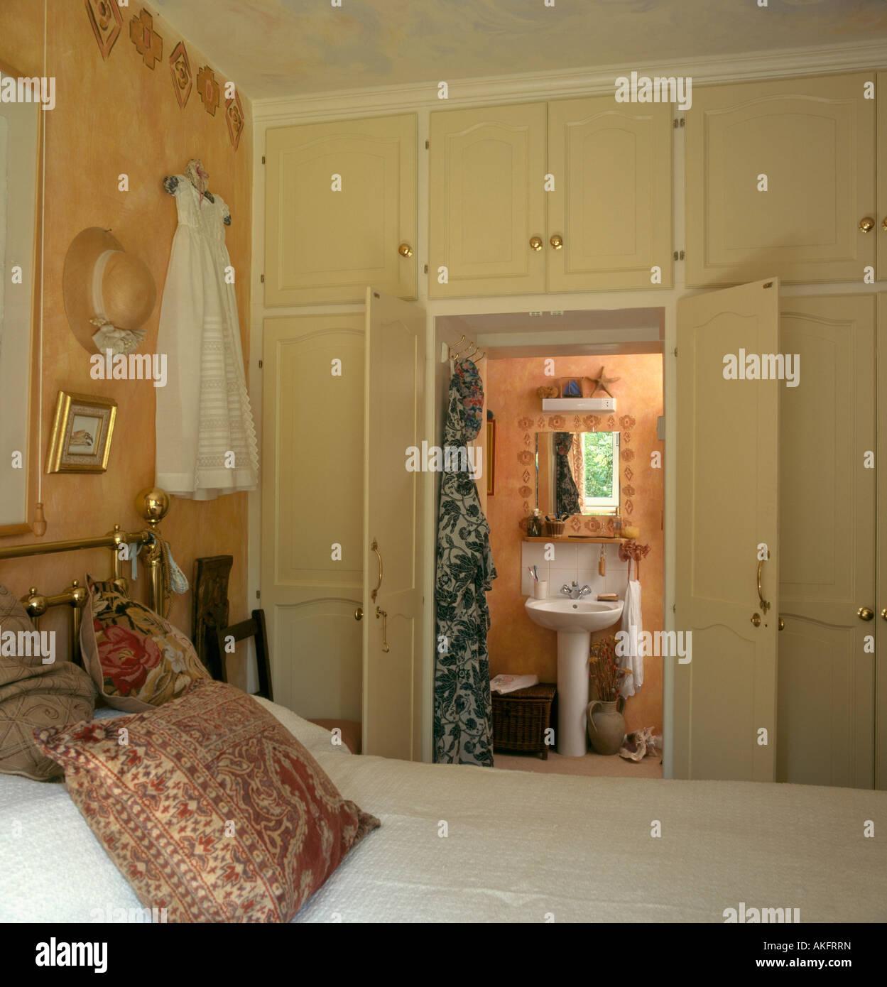 Bedroom with built in storage cupboards over doorway with ...