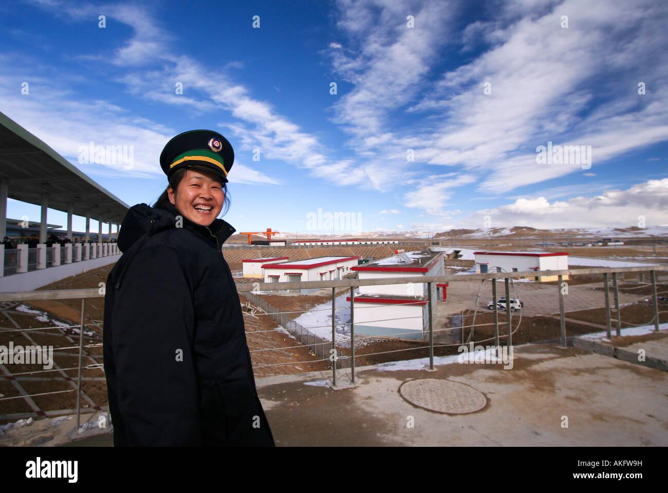 Railway s female worker from the Tibet Qinghai Railway s Tangula Express. - Stock Image