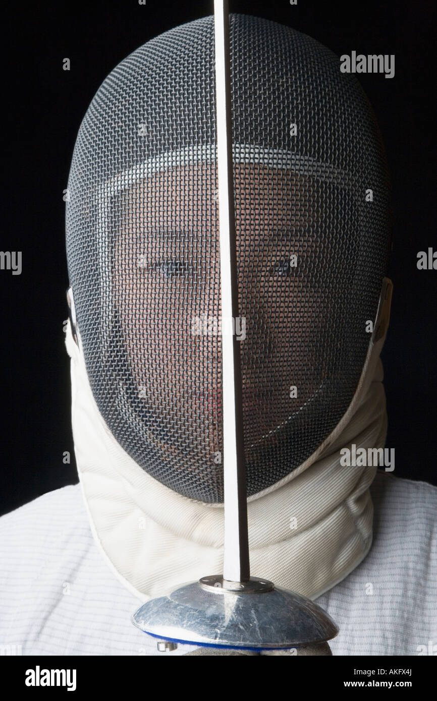 Portrait of a female fencer holding a fencing foil in front of her