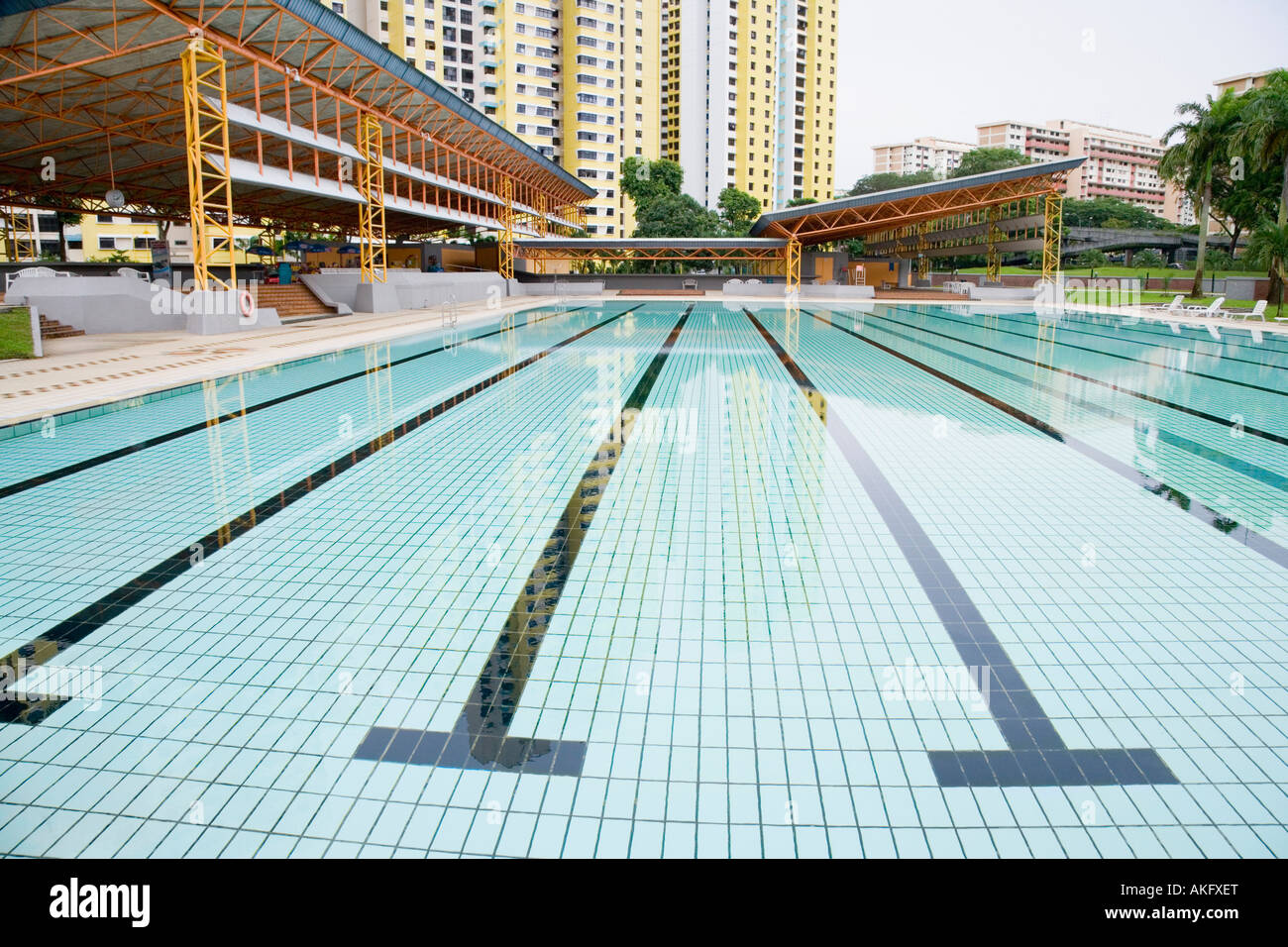 Swimming pool in front of buildings, Clementi Swimming ...