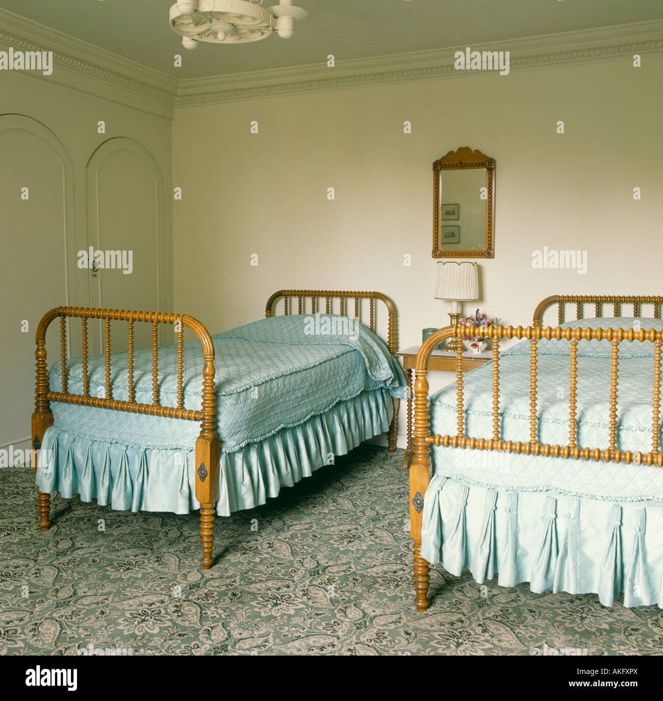 Spindle Balusters On Antique Wooden Twin Beds In Traditional Bedroom
