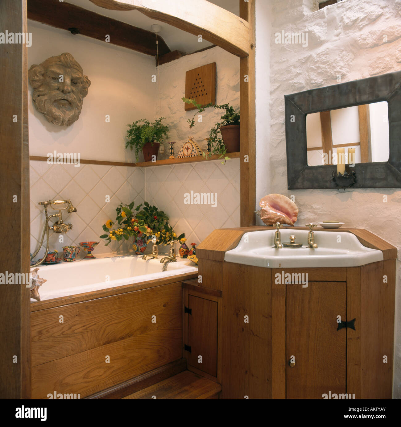Pine panelling on bath and built in basin in small cottage bathroom ...