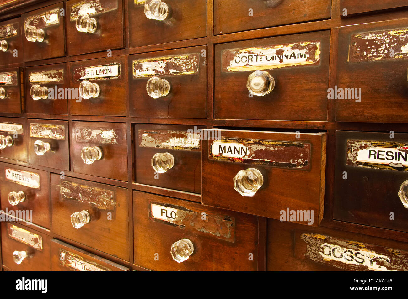 Antique apothecary chest of drawers UK - Stock Image