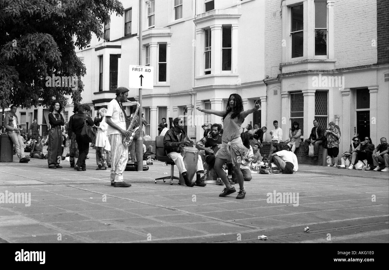 Young girl dancing at Notting Hill Carnival - Stock Image