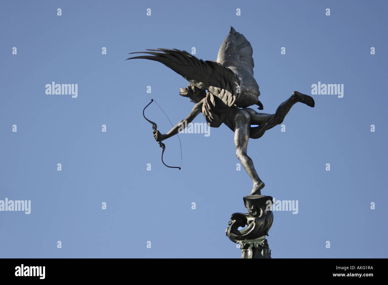 Eros statue on top of fountain at Picadilly Circus in London. - Stock Image