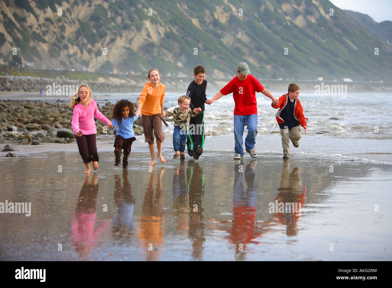 Children Running on Beach Mussel Shoals Carpenteria Santa Barbara County California United States (MR) - Stock Image