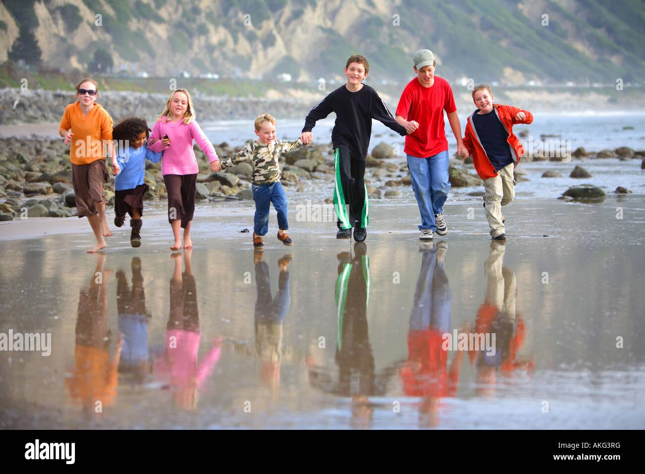 Children Running on Beach Mussel Shoals Carpenteria Santa Barbara County California United States (MR) Stock Photo