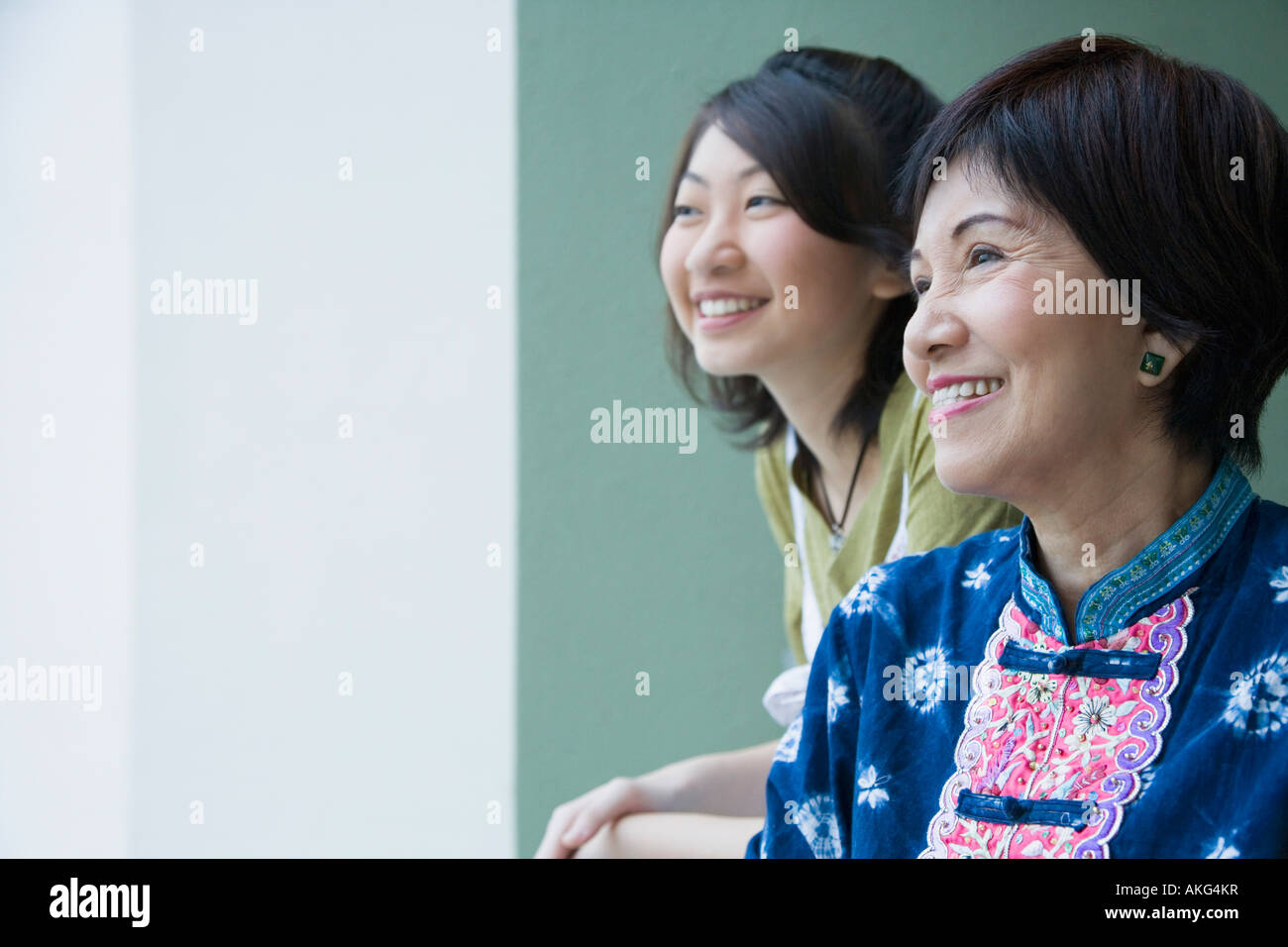 Close-up of a senior woman smiling with her granddaughter - Stock Image