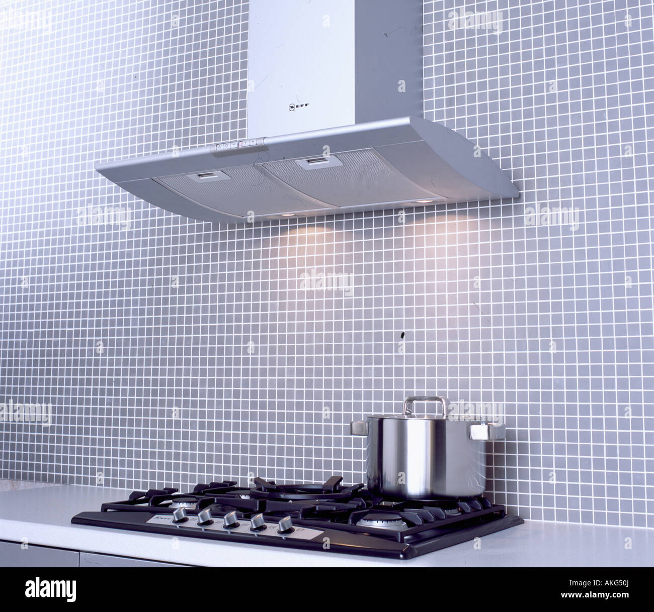 Close Up Of Extractor Fan Above Stainless Steel Pan On Black Hob In Stock Photo Alamy