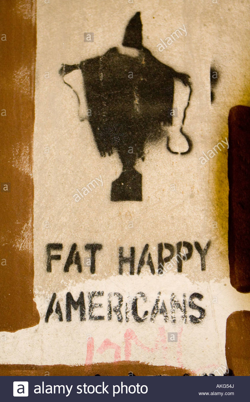 graffiti showing the image of tortured inmates at abu ghraib prison in iraq with the slogan fat happy americans - Stock Image