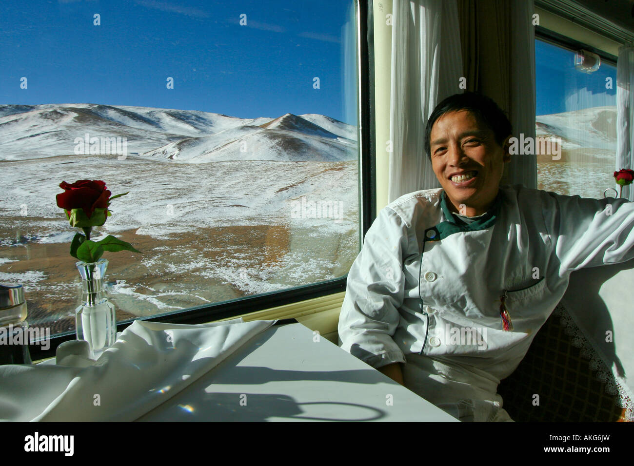 Chinese train cook having a rest on the Tibet Qinghai Railway s Tangula Express Stock Photo