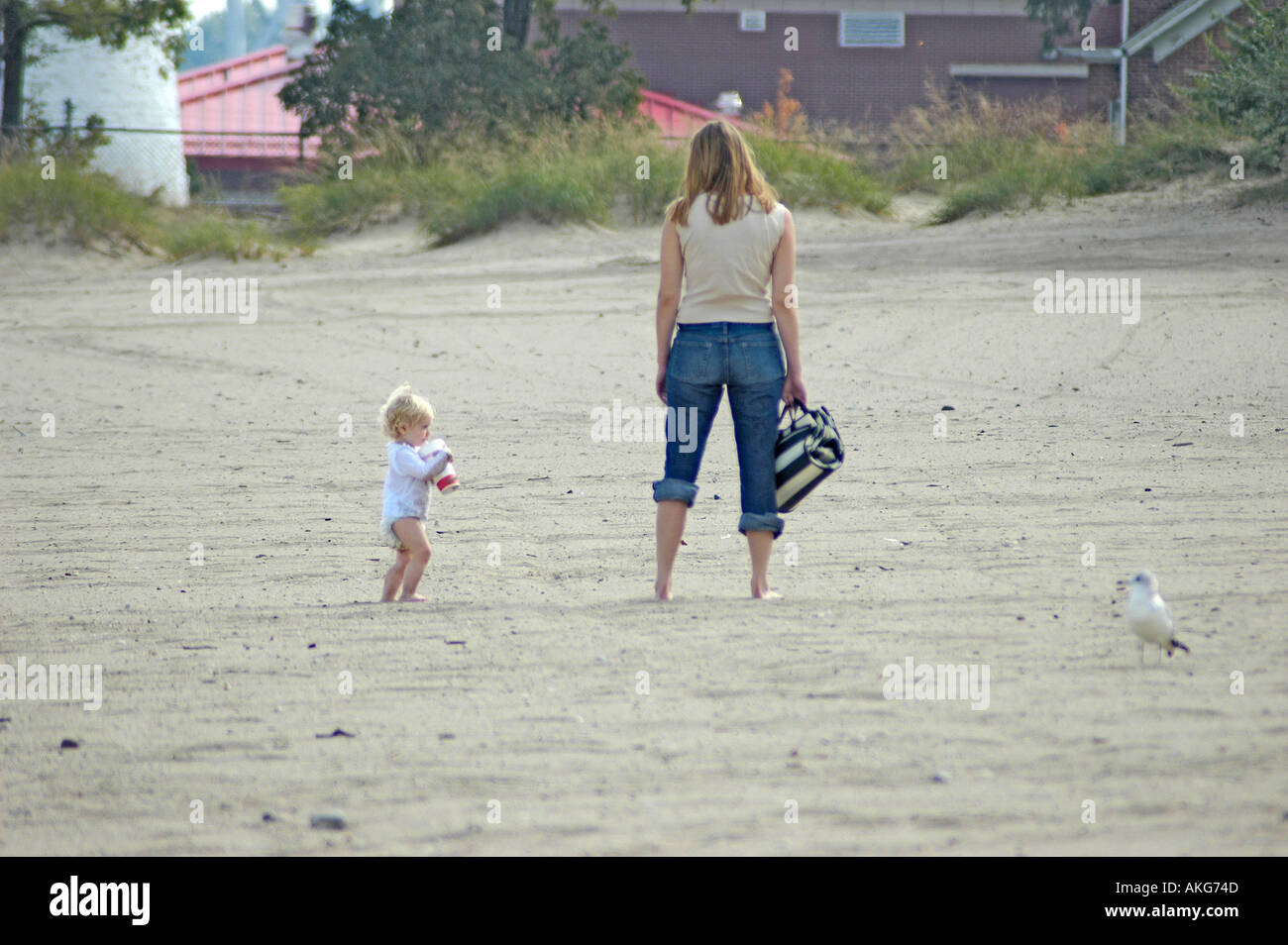Mother and toddler at the beach on the Great Lakes Michigan Family Stock Photo