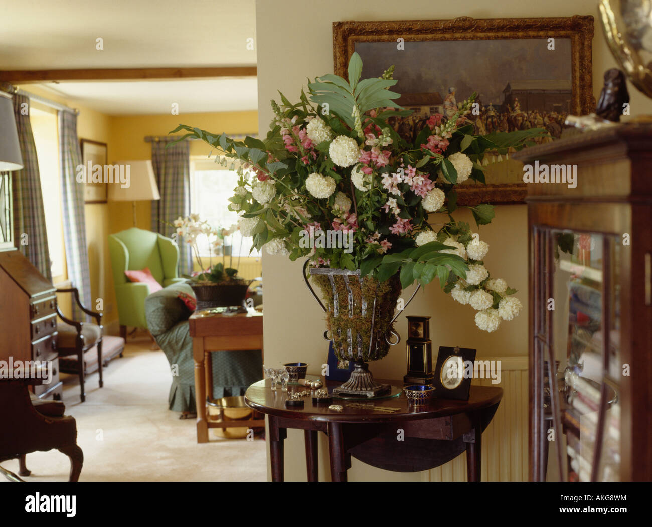 Large Floral Arrangement In Urn On Antique Console Table In Cottage