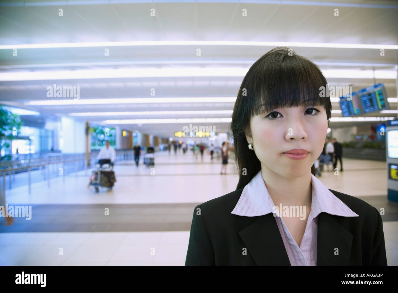 Portrait of a businesswoman at an airport Stock Photo