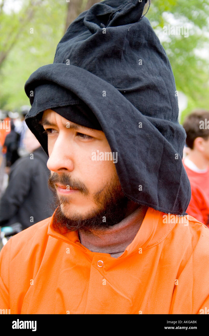 Hooded parade participant age 24 ready to join his unit for the march. MayDay Parade and Festival. Minneapolis Minnesota - Stock Image